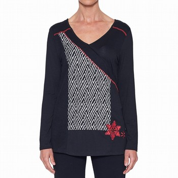 This spliced top embodies total comfort for winter. Made from a variety of                                                                                       plain and jacquard knit panels in trendy black and white, the top also                                                                                           features a complementary V neckline and long sleeves in soft jersey. WIth red                                                                                    blanket stitching and red embroidered flowers on the hip, the top has a                                                                                          flattering flow to the upper thigh on most.