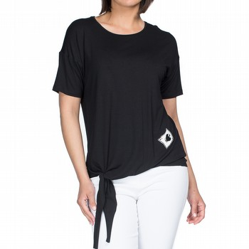 The Tie Front Tee by Threadz is a relaxed fit black jersey tee featuring                                                                                         an embroidered card patch on the left side and tie detailing on the right.                                                                                       Model wears size 10 and stands 178cm tall.