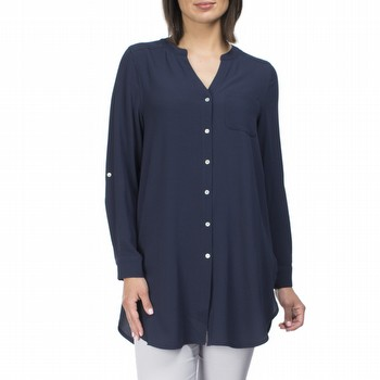 The Longline Shirt from the Clarity Essentials Collection                                                                                                        will fast become your winter wardrobe go-to for style and comfort.                                                                                               In a fine crepe this tunic style shirt features a V neckline, a long tab up                                                                                      sleeve and a button through with pretty mother of pearl buttons. So easy to                                                                                      wear and layer as the weather becomes cool this easy fit style doesn't ever                                                                                      need ironing! Available in navy and ivory throughout the season.                                                                                                 Models both wear Size S and stand 178cm tall.