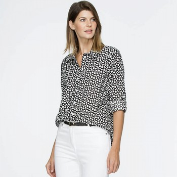 The Dot Linen Shirt by Gordon Smith is  your go-to for                                                                                                           trans-seasonal wardrobe options. In a comfortable linen and                                                                                                      cotton blend this black and white spotted shirt features a long cuffed sleeve                                                                                    with a tab up feature for warmer days. With a soft collar, a shirt maker hem and                                                                                 contrasting white buttons this shirt is one of a kind. Light weight enough to be                                                                                 worn tucked in or out.                                                                                                                                           Models wear Size S and stand 178cm and 180cm tall respectively.