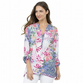 The Floral Print Embellished Top by Threadz is a pretty print tunic style top                                                                                    in a silk-touch poly featuring an all over photographic floral and                                                                                               geometric print. Embellished on the front with tiny sparkling diamond                                                                                            shaped studs this stunning colourful top also features pretty clear buttons, a                                                                                   handy tab -up long sleeve and a V neckline with a nehru style collar.                                                                                            Pair back with a skinny jean and heeled sandals for a fabulous casual summer                                                                                     party look! Available in two colourways. Models wear Size S and stand 175cm and                                                                                  178cm tall.
