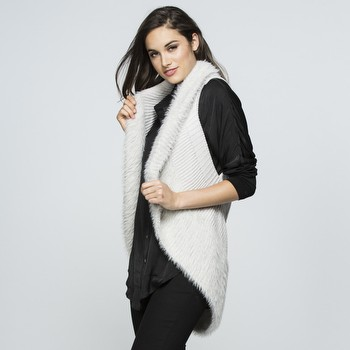 The Faux Fur Knit Vest by Threadz will be your new best friend!                                                                                                  This fabulous addtion to your wardrobe will add style, comfort and                                                                                               extra warmth to any of your smart casual looks. Pair back with a long sleeve                                                                                     Tshirt and any denim for a casual day out, and layer up over knitwear,                                                                                           jeans and boots when the weather cools down.                                                                                                                     In a comfortable knit with a curved hemline this vest features a faux                                                                                            fur trim on the neckline which follows around to the hemline on                                                                                                  a circular shape. Available in Black, Navy, Natural, Pale Pink and Pale Blue.